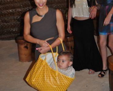 Kim-Kardashian-Mason-Dash-Disick-Purse-Bora-Bora-Family-Dinner-091211-492x740