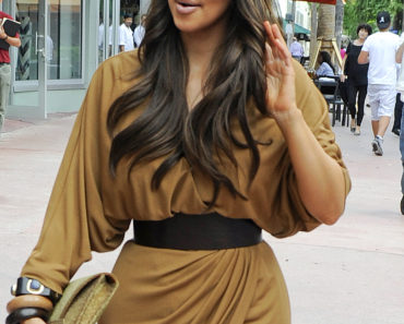 Kim Kardashian Shows Off Her Faux Tan And Carries A Bedazzled Camera