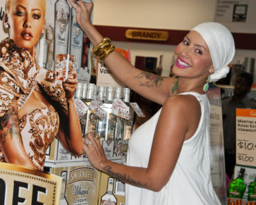 Amber Rose Hosts Smirnoff Fluffed Marshmallow and Whipped Cream Flavored Vodkas Bottle Signing at PA Wine and Spirits Premium Collection Store in Philadelphia - July 12, 2012