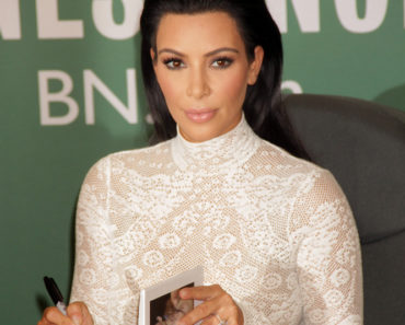 "05/05/2015 - Kim Kardashian - Kim Kardashian ""Selfish"" Book Signing at Barnes & Noble in New York City on May 5, 2015 - Barnes & Noble - New York City, NY, USA - Keywords: 1/2 length shot, vertical, ring, jewelry, ""Keeping Up with the Kardashians"", celebrity, celebrities, reality television, arts culture and entertainment, white dress, long black hair Orientation: Portrait Face Count: 1 - False - Photo Credit: PRN / PRPhotos.com - Contact (1-866-551-7827) - Portrait Face Count: 1"