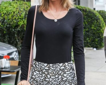 05/08/2015 - Taylor Swift - Taylor Swift Sighted Arriving at Jack n' Jill's Too in Los Angeles on May 8, 2015 - Jack n' Jill's Too, 8738 W. 3rd Street - Los Angeles, CA, USA - Keywords: celebrity, singer, blonde, country, pop, songwriter, black shirt, black and white skirt Orientation: Portrait Face Count: 1 - False - Photo Credit:  Arielle Madnick / PRPhotos.com - Contact (1-866-551-7827) - Portrait Face Count: 1