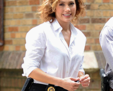 "07/08/2015 - Jennifer Lopez - Jennifer Lopez Sighted on the Set of ""Shades of Blue"" in New York City on July 8, 2015 - Street - New York City, NY, USA - Keywords: 3/4 Length Shot, Car Keys, Black Gun Holster, Black Pants, Police Badge, Gold Ring, Jewelry, Gold Watch, Gold Earrings, White Blouse, Shoulder Length Wavy Brown Hair, Brunette, Actress, Singer, Songwriter, Vertical, NYC, Arts Culture and Entertainment, Film Set, Celebrities, Celebrity, Candid, ""Shades of Blue"" Television Show Orientation: Portrait Face Count: 1 - False - Photo Credit: GWR / PRPhotos.com - Contact (1-866-551-7827) - Portrait Face Count: 1"