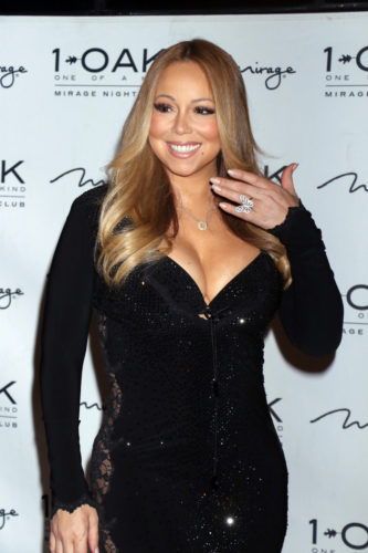 07/25/2015 - Mariah Carey - Mariah Carey Hosts the Evening at 1Oak Nightclub in Las Vegas on July 25, 2015 - 1Oak Nightclub at the Mirage Hotel & Casino - Las Vegas, NV, USA - Keywords: 1/2 Length Shot, Butterfly Ring, Full Length Long Sleeve Black Lace and Sequin Dress, Necklace, Heart Shaped Pendant, Jewelry, Long Wavy Brown Hair, Brunette, Party Host, American singer, musician, music, pop star, songwriter, record producer, actress, woman, person, people, celebrity, celebrities, performer, portrait, vertical, arts culture and entertainment, Nevada, photocall, arrival Orientation: Portrait Face Count: 1 - False - Photo Credit: PRN / PRPhotos.com - Contact (1-866-551-7827) - Portrait Face Count: 1
