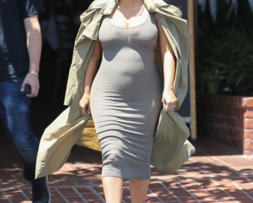 """07/16/2015 - Kim Kardashian - Kim Kardashian Sighted in Los Angeles on July 16, 2015 - Street - Los Angeles, CA, USA - Keywords: Grey Rope High Heel Shoes, Full Length Shot, Green Coat, Sleeveless Grey Dress, Gray Dress, People, Vertical, Fashion, Model, Pulled Back Long Wavy Black Hair, Updo, Sunglasses, Shades, California, City Of Los Angeles, One Person, Woman, Pregnant, Baby Bump, Incidental People, Arts Culture and Entertainment, Celebrities, """"Keeping Up With the Kardashians"""", Reality TV Star, Celebrity Sightings, Candid Orientation: Portrait Face Count: 1 - False - Photo Credit:  / PRPhotos.com - Contact (1-866-551-7827) - Portrait Face Count: 1"""