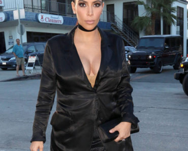 "07/13/2015 - Kim Kardashian - Kim Kardashian Sighted Arriving at Craig's in West Hollywood on July 13, 2015 - Craig's - West Hollywood, CA, USA - Keywords: 3/4 Length Shot, People, Vertical, Black Clutch Bag, Pocketbook, Handbag, Black fringe dress, Black Jacket, Fashion, Model, Pulled Back Long Wavy Black Hair, Updo, Diamond Earrings, Diamond Stud Earrings, Jewelry, California, City Of Los Angeles, One Person, Woman, Pregnant, Incidental People, Arts Culture and Entertainment, Celebrities, ""Keeping Up With the Kardashians"", Reality TV Star, Celebrity Sightings, Candid Orientation: Portrait Face Count: 1 - False - Photo Credit: KeithJMX / PRPhotos.com - Contact (1-866-551-7827) - Portrait Face Count: 1"