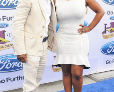 08/09/2014 - Todd Tucker, Kandi Burruss - 2014 Ford Neighborhood Awards - Arrivals - Philips Arena - Atlanta, GA, USA - Keywords: full length shot, dress, singer, spouse, real housewives of atlanta, rhoa Orientation: Portrait Face Count: 1 - False - Photo Credit: Aaron J. Thornton / PR Photos - Contact (1-866-551-7827) - Portrait Face Count: 1