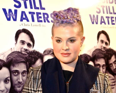 "11/16/2014 - Kelly Osbourne - ""Beside Still Waters"" - Los Angeles Premiere - Arrivals  - Laemmle Music Hall Theatre - Beverly Hills, CA, USA - Keywords: Headshot, movie billboards, Beverly Hills movie premiere, Arts Culture and Entertainment, Celebrities, Topix, Bestof, Celebrity, Ozzy Osbourne's daughter, winter coat, black and white coat, shaved head, Purple Mohawk Hair, E Network, Television personality, TV Star, Reality TV Star  Orientation: Portrait Face Count: 1 - False - Photo Credit: Jonathan  Shensa / PR Photos - Contact (1-866-551-7827) - Portrait Face Count: 1"