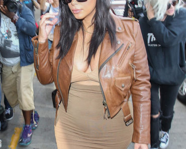 "08/03/2015 - Kim Kardashian - Kim Kardashian Sighted at LAX Airport on August 3, 2015 - Los Angeles International Airport - Los Angeles, CA, USA - Keywords: 3/4 Length Shot, Ring, Necklace, Jewelry, Brown Leather Jacket, Brown Jacket, french manicure, white and tan nail polish, white and tan fingernail polish, Vertical, baby bump, pregnant, with child, tan and brown dress, long wavy black hair, Sunglasses. People, California, One Person, Beauty, Television Show, Portrait, Fashion, Arts Culture and Entertainment, Celebrities, ""Keeping up with the Kardashians"", Topix, Bestof, Reality TV Star, Celebrity Sighting, Candid, Travel, Walking, Woman, Model Orientation: Portrait Face Count: 1 - False - Photo Credit:  / PRPhotos.com - Contact (1-866-551-7827) - Portrait Face Count: 1"