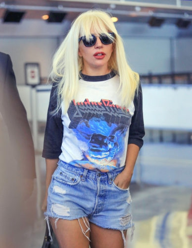 10/06/2015 - Lady Gaga - Lady Gaga Sighted Arriving at JFK Airport in New York City on October 6, 2015 - John F. Kennedy International Airport - New York City, NY, USA - Keywords: 3/4 Length Shot, Black Pocketbook, Purse, Handbag, Bag, Vertical, Torn Blue Denim Jeans Shorts, Black and White Judas Priest Concert Shirt, Sunglasses, Long Blond Hair, Stefani Germanotta, Stefani Joanne Angelina Germanotta, American singer, songwriter, actress, Arts Culture and Entertainment, Travel, Walking, Person, Woman, Performer, Candid Orientation: Portrait Face Count: 1 - False - Photo Credit: XPX / PRPhotos.com - Contact (1-866-551-7827) - Portrait Face Count: 1