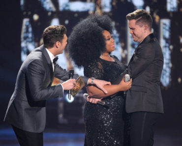 HOLLYWOOD, CA - APRIL 7: Judge Ryan Seacrest (L) announces American Idol Season 15 winner Trent Harmon (R) with runner-up La'Porsha Renae, onstage at FOX's American Idol Season 15 Finale on April 7, 2016 at the Dolby Theatre in Hollywood, California. (Photo by FOX via Getty Images) *** Local Caption *** Ryan Seacrest; La'Porsha Renae; Trent Harmon